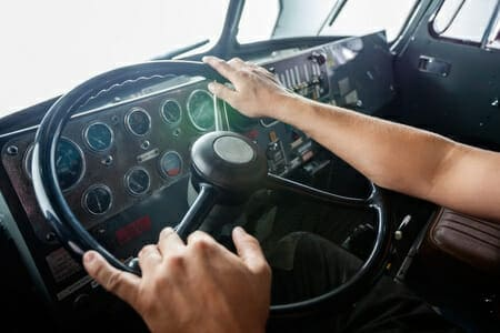 Truck Driver Holding a Steering Wheel