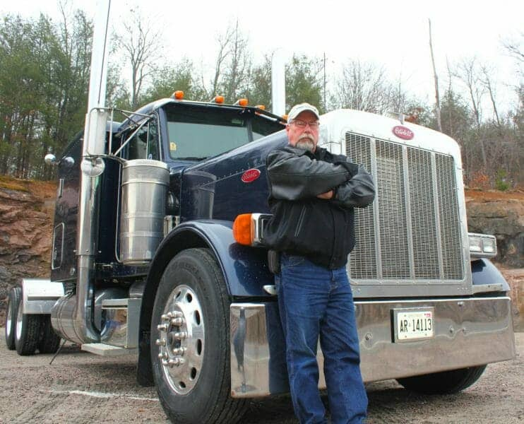 Experienced Veteran Truck Driver Smart Trucking Leaning on 379 Peterbilt 40 year Trucking Career