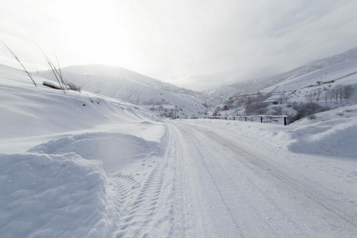 Winter Road Snow Covered in Mountain Area Safe Winter Driving Tips
