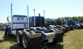 Line up of Big Rig Trucks