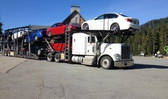 White Peterbilt Big Rig Car Hauler