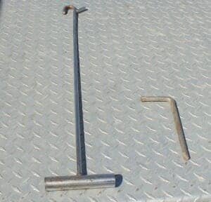 Fifth wheel hook and cam wrench