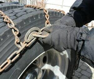 Semi truck chaining up