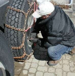 Tightening Tire Chains on Big Rig