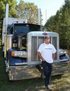 Truck driver with big rig Peterbilt