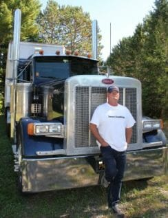 Owner Operator Standing by His Peterbilt Big Rig
