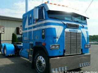 Blue Cabover Freightliner Front View