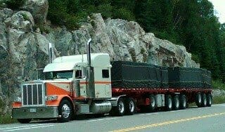 Peterbilt Owner Operator Truck with Flatbed Trailer