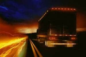 Big Rig on Highway at Night with Chicken Lights