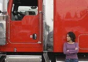 Female Trucker with Red Big Rig