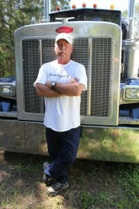 Trucker with his 2004 379 Blue Peterbilt