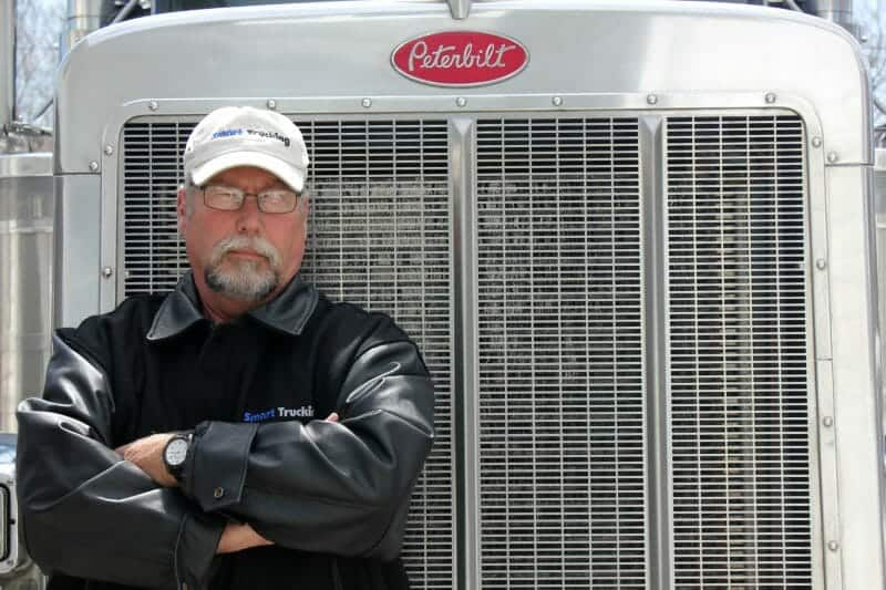Trucker standing by Peterbilt Big Rig