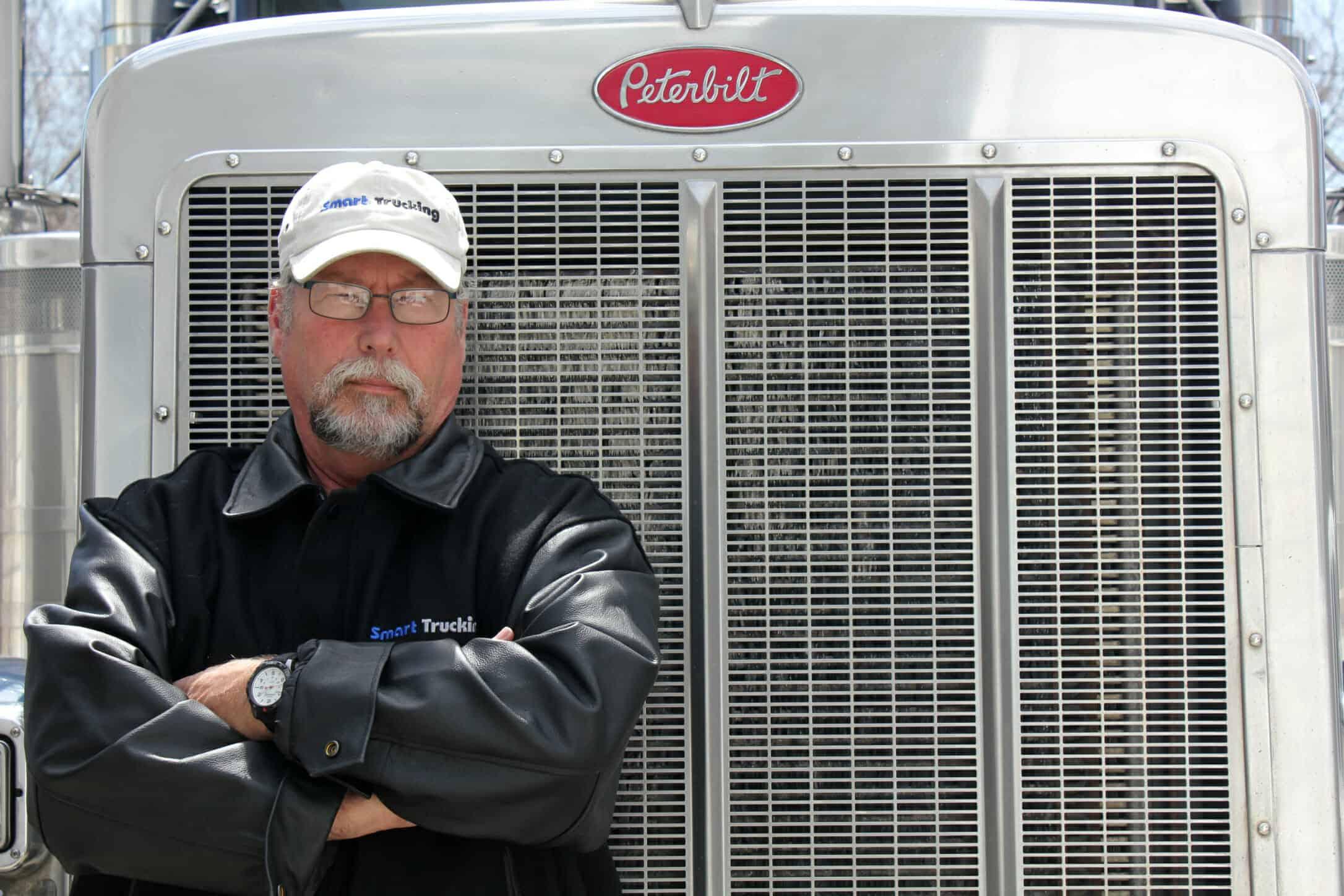 Trucker standing by Peterbilt Big Rig