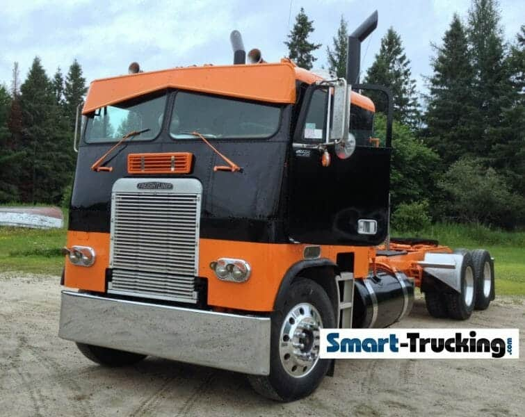 Orange Black Freightliner Cabover
