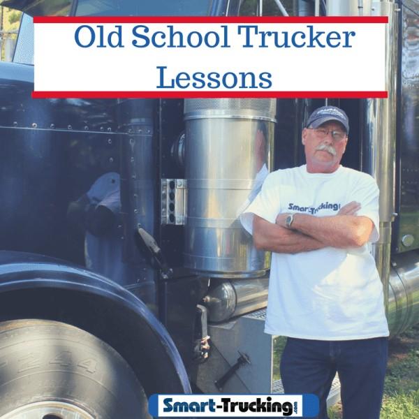 Old school trucker standing by blue big rig