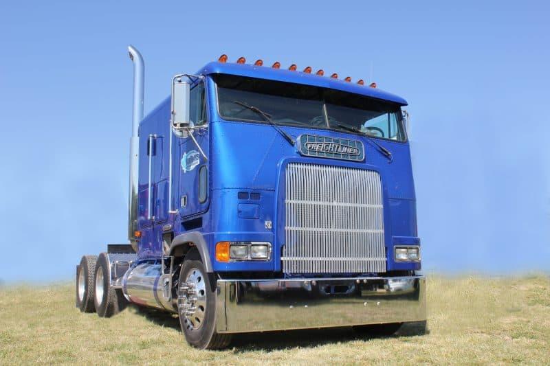 Royal Blue Freightliner Cabover Truck