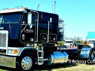 Dark blue Freightliner Cabover