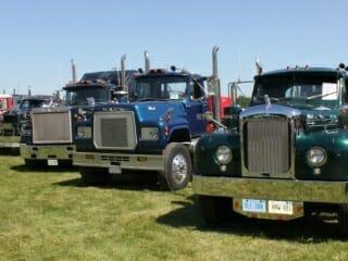 Row of Older Model Mack Trucks Superliner R Model B61 Thermodyne Models