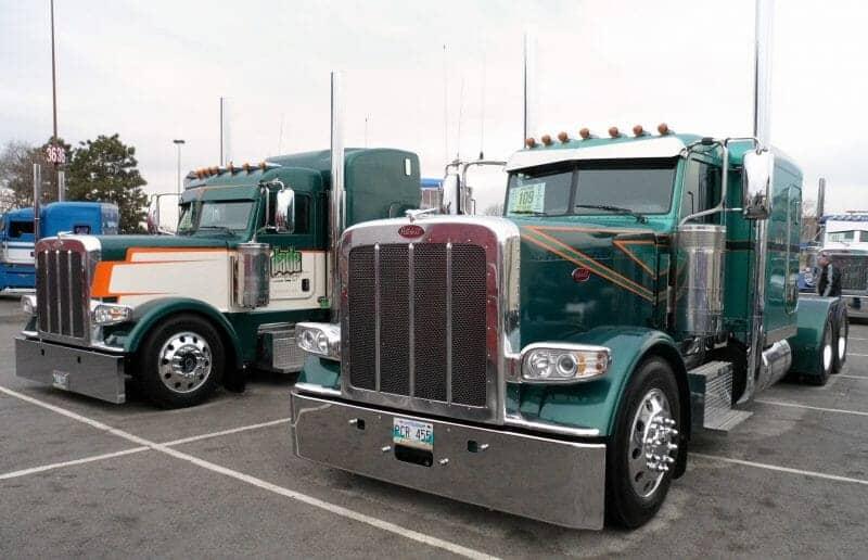 Two 389 Peterbilt Trucks Jade Transport