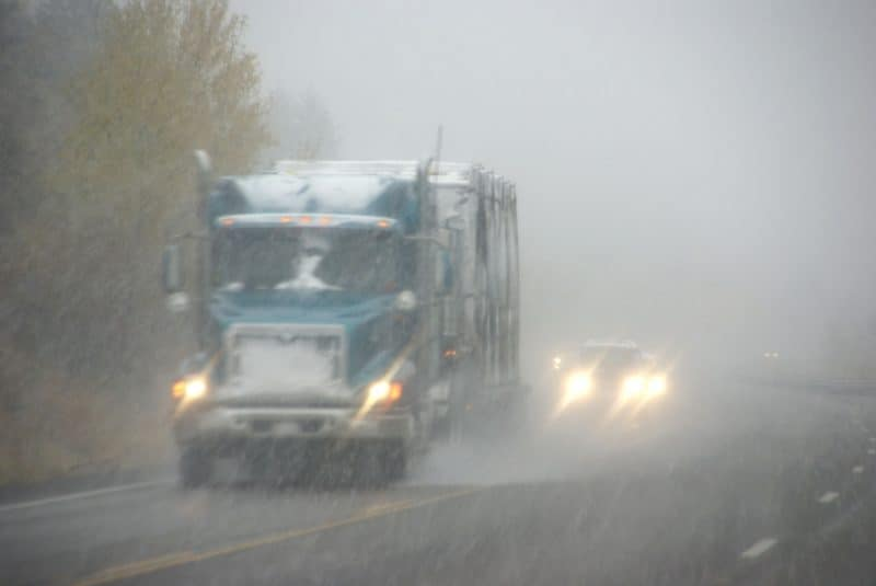 Big Rig Driving in Fog and Storm
