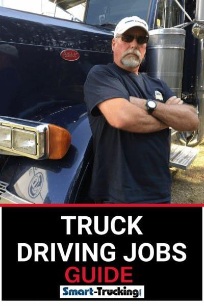 Truck driver standing beside truck