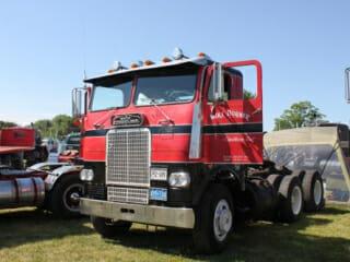 Red Black White Freightliner Cabover