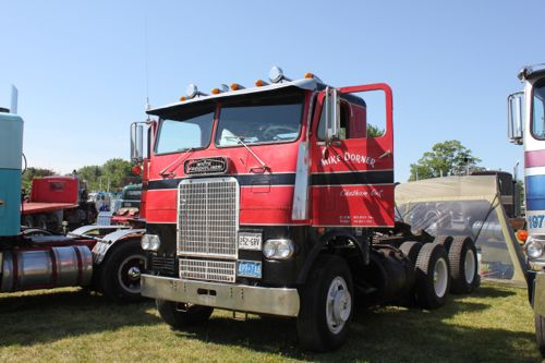 Red Black White Freightliner Cabover