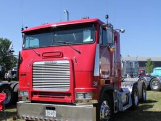 Red Freightliner Cabover