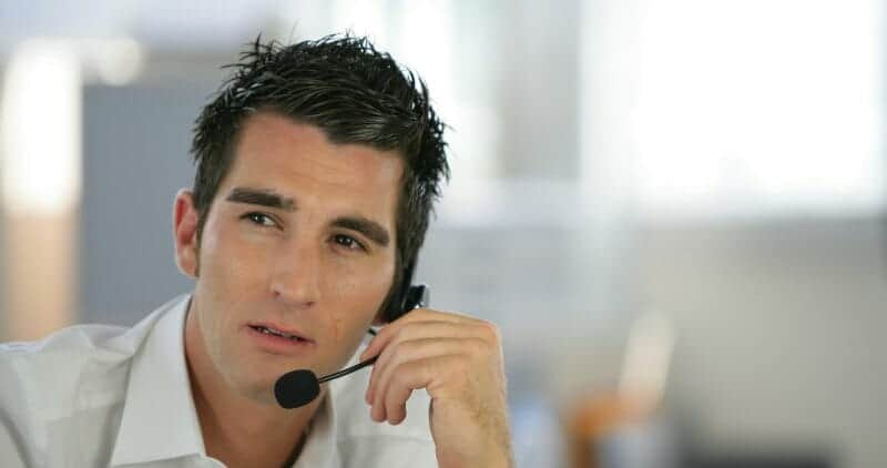 Dispatcher at trucking company on telephone headset