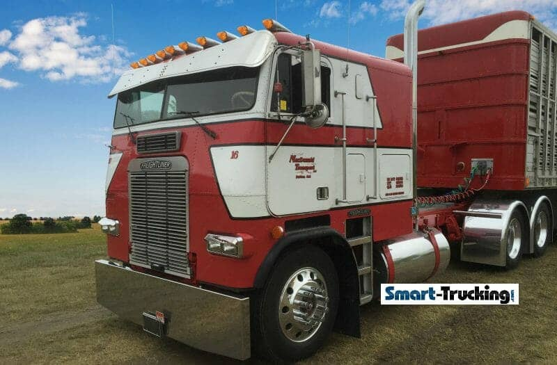 Red and White Freightliner Cabover with Trailer