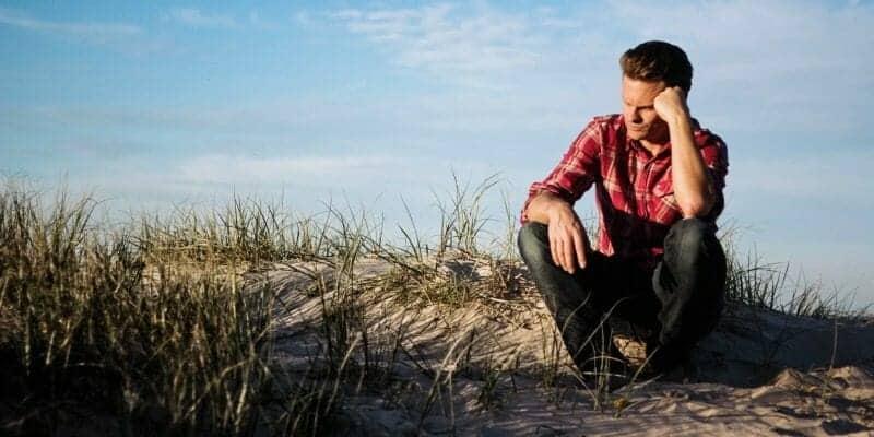 Adult mental health man thinking at beach