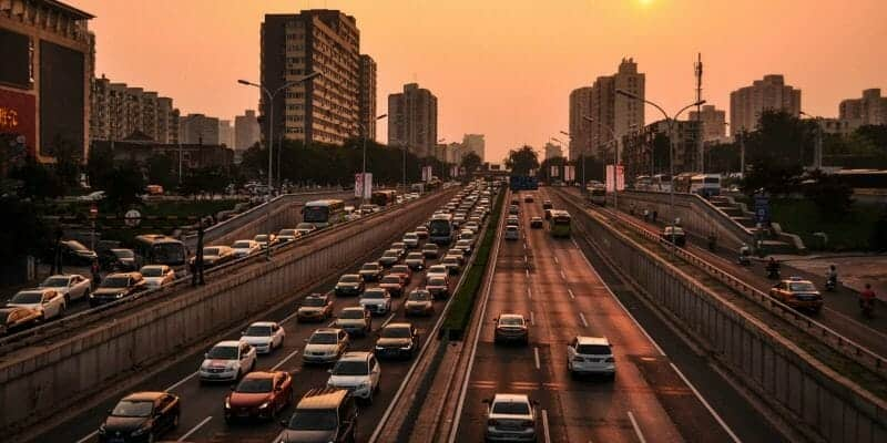 Cars on busy city freeway at sunset