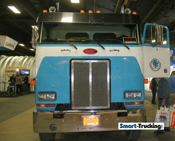 Blue White Cabover Truck Front Grill View