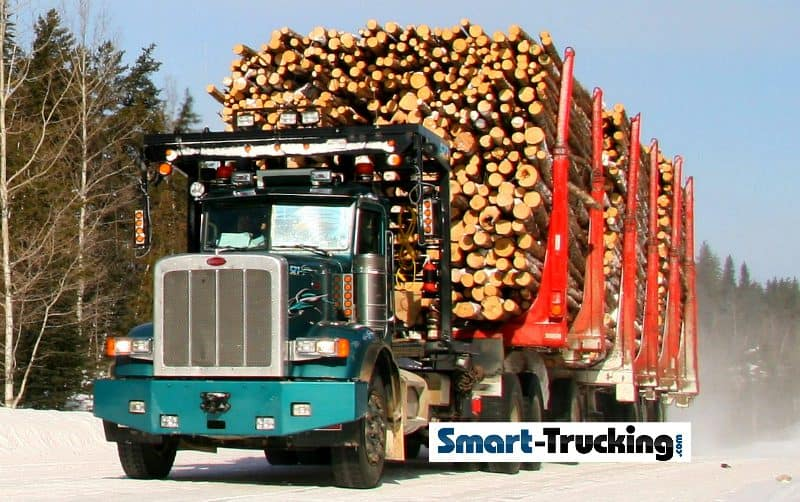 Green Peterbilt Logging Truck Loaded to Max