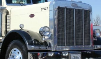White and black front view of a 359 Peterbilt Truck