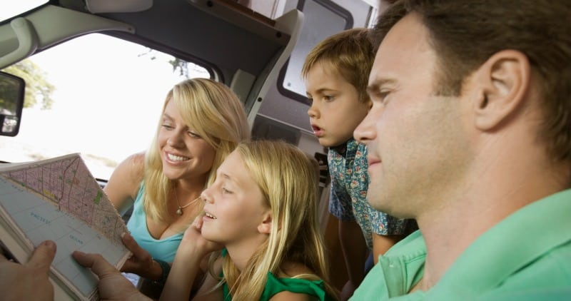 Family looking at road map on vacation