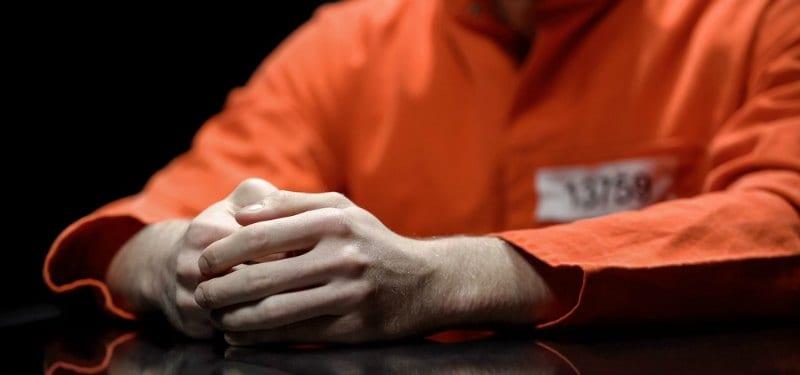 Man in jail in orange suit