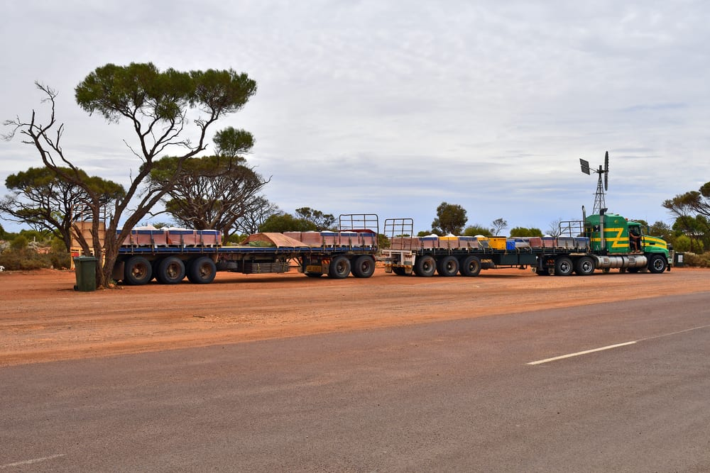 Truck usually called Road Train with trailers at outback roadhouse on Stuart highway in South Australia