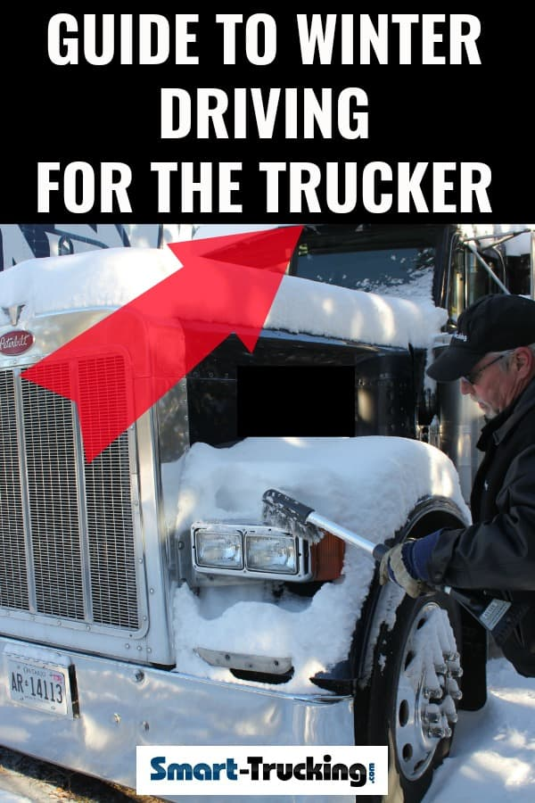 TRUCK DRIVER CLEANING SNOW OFF BIG RIG