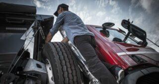 Truck driver standing near truck - trucking career