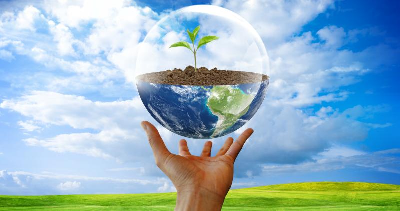 Green earth in a hand. Environmental friendly trucks